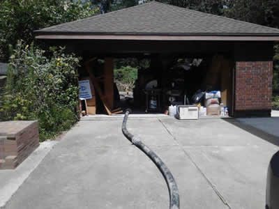 concrete pumped through garage to backyard